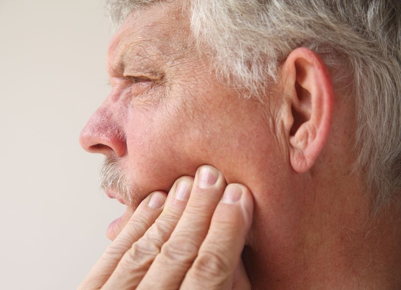 man with pain in his jaw