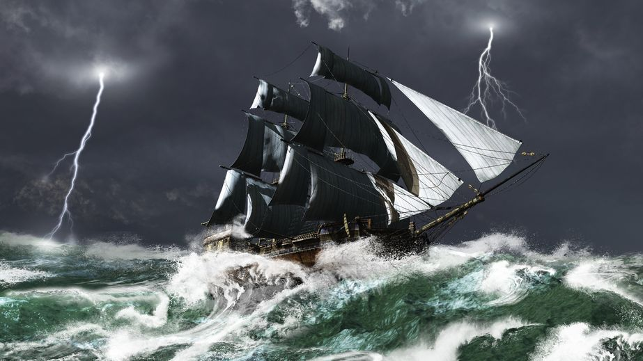 Tall ship sailing in heavy seas in a lightning storm