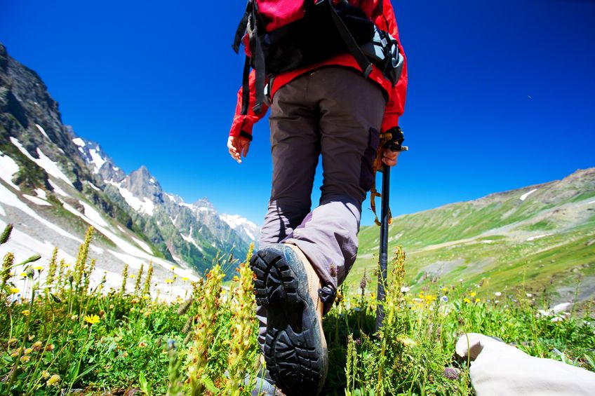 a hiker walking in mountains