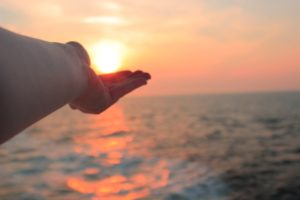 Hand holding the sunset