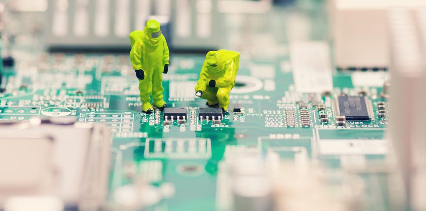 Miniatures of technicians repairing a circuit board