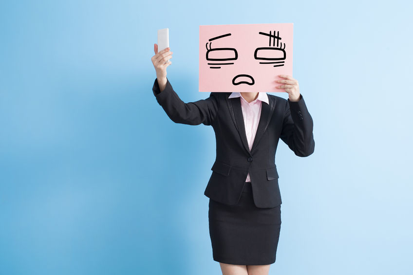 business woman take tired billboard and selfie, isolated blue background