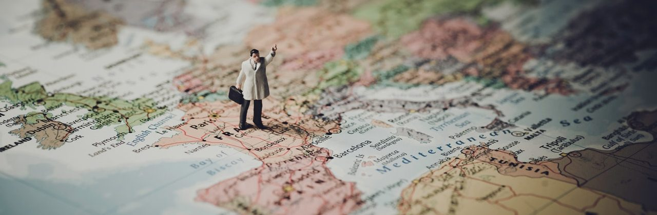 Miniature man on a map