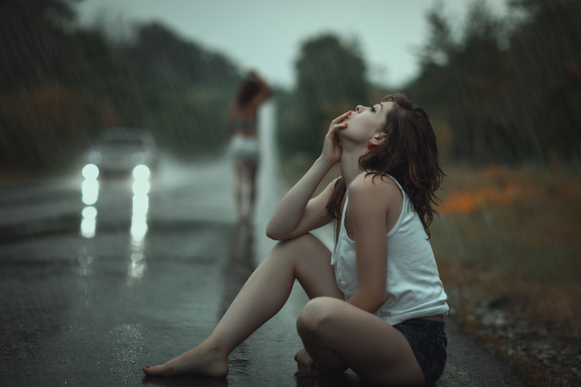 woman in the rain and sad, from saying goodbye